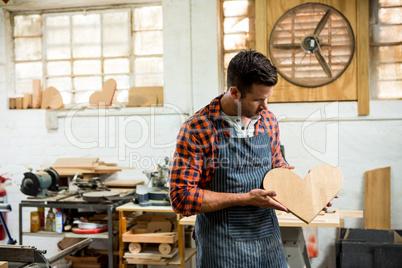 carpenter looking at his craft