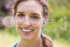 Smiling woman wearing earphones