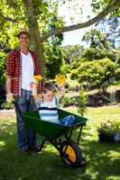 Father carrying his son in a wheelbarrow