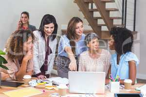 Group of interior designers interacting with each other