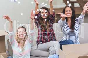 Playful friends playing with packing peanuts