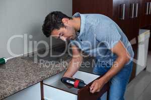 Man using cordless hand drill