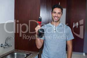 Happy man holding cordless hand drill