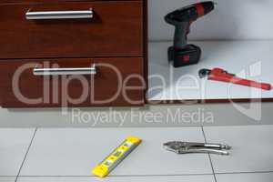 Various work tools near drawer