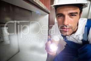 Portrait of man holding illuminated torch