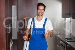 Man doing pest control in kitchen