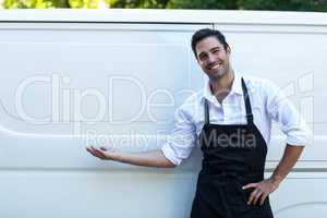 Portrait of confident delivery man with blank space
