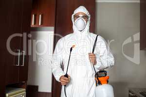 Portrait of pest worker in protective suit