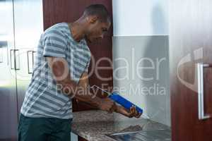 Man using pest control injection