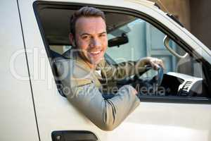 Delivery man driving in his van