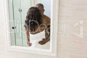 Reflection of young couple standing face to face