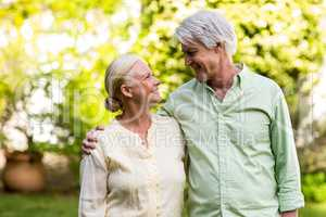 Couple looking each other while standing in yard