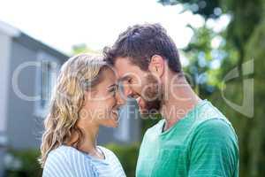 Couple touching head in yard