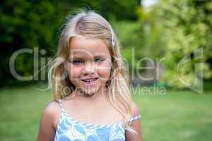 Portrait of cute girl in back yard
