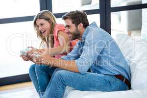 Young man and woman playing video game