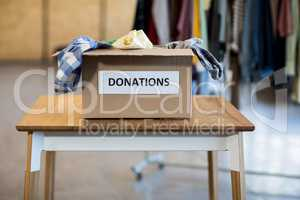 Donation box on a wooden table
