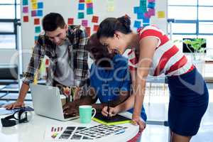 Graphic designers working at their desk