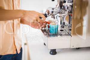 Man preparing coffee from coffeemaker