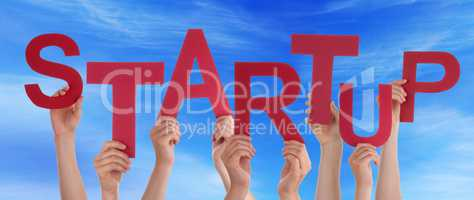 Many People Hands Holding Red Word Startup Blue Sky