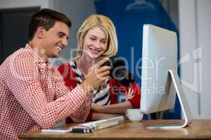 Colleagues looking at photos in camera