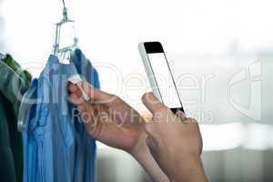 Woman clicking photo tag of garment