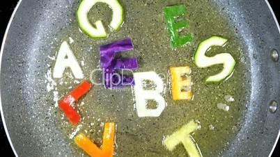 Stir-frying mixed alphabet letters, word Vegetables