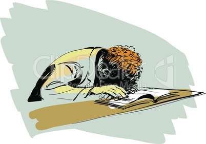 boy asleep on a textbook education school