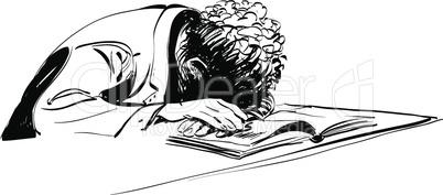 boy asleep on a textbook education school