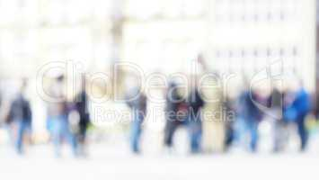 Un-focused blurred queue of unidentifiable people