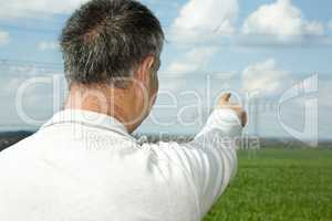 Farmer with hint about his field