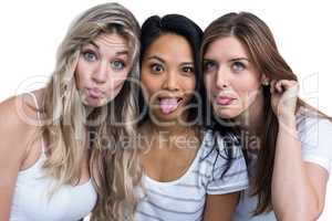 Multiethnic women making funny faces