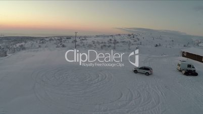 Car drifting on snow, aerial view