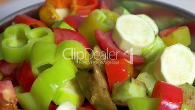Adding cut vegetables in salad