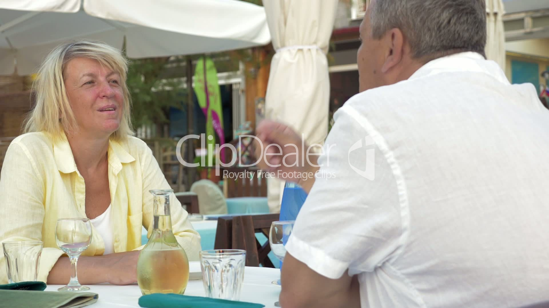 Man and woman sitting in restaurant, talking and laughing