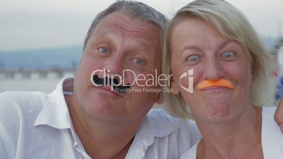Funny senior couple with moustache