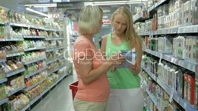 Adult Mother and Daughter in the Food Shop