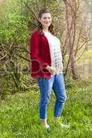 Pregnant woman in red jacket with calendar on her T-shirt