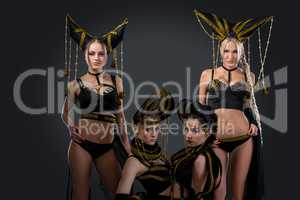 Dance group in sexy costumes with headdresses