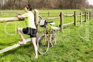 Woman with bike on the paddock