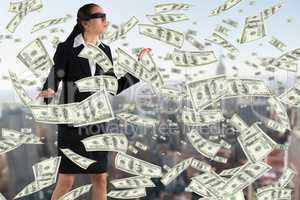 Composite image of blindfolded businesswoman with hands out
