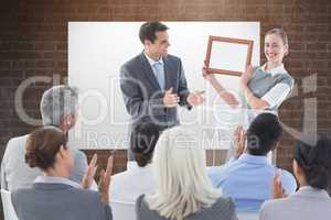 Composite image of business people receiving award