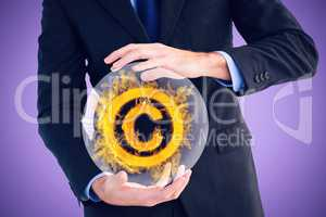 Composite image of mid section of a businessman presenting with his hands