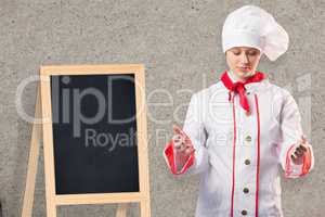 Composite image of pretty chef standing with hands out