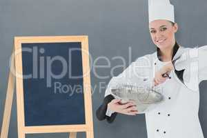 Composite image of happy female chef holding wire whisk and mixing bowl