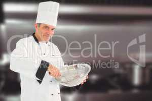 Composite image of mature chef using whisk and mixing bowl
