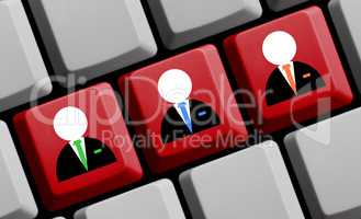Drei Business Symbole auf Computer Tastatur