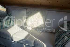 Sunbeam Falls on a White Sofa