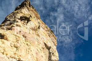 Sandstone Rock on a Background of Blue Sky