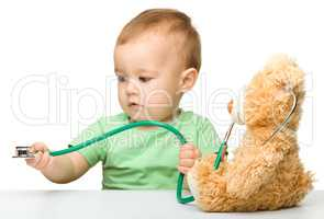 Little boy is playing doctor with stethoscope