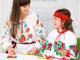 Mother and child in Ukrainian national cloth